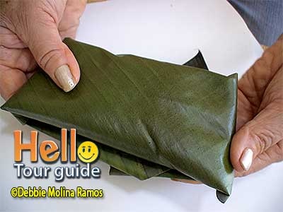pastel wrapped in banana leaf